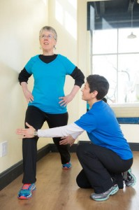 Susan Silver helping client with lunge.