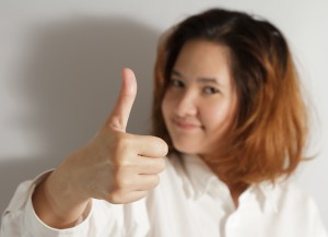 businesswoman holding thumps up