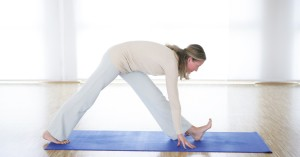 woman stretching hamstrings